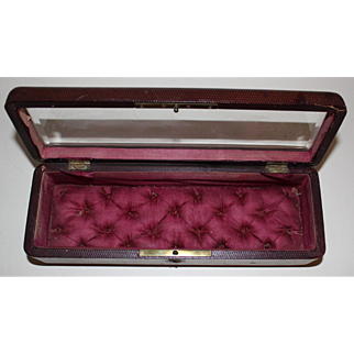 Burgundy Embossed Leather Glass topped box with an opulent silk padded lining. c. 1850-70s