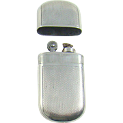 A Vintage Silver Cased Cigarette Lighter, 1946