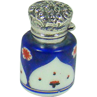 A Small Antique Silver Topped Perfume Bottle, 1894.