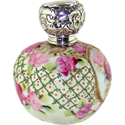 An Edwardian Silver capped perfume bottle, 1910.