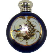 A Small Antique Perfume Bottle With A Silver Screw Cap On A Glazed Pottery Body, 1905.