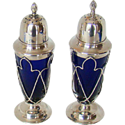 A Stylish Pair Of Antique Silver Peppers, 1906.