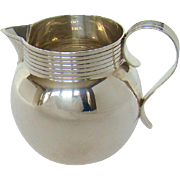 A Silver George V Art Deco Style, Milk Jug, 1930.