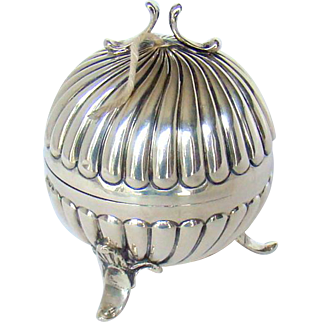 An Antique Silver String Container, 1900.