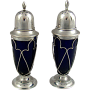 A Pair Of Edwardian Silver And Blue Glass Lined Peppers, 1906.