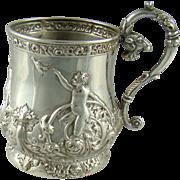 An Edwardian Silver Cherub Embossed Mug, 1904.