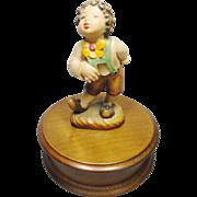 Wood Carved Arni figurine Boy with Flower Music Box