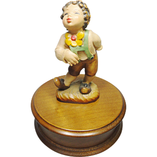 Wood Carved Arni figurine Boy with Flower Music Box