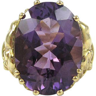Wonderful Oval 11 carat Amethyst set in 10k yellow gold filigree mounting  Ring size 7 makes it perfect for index finger