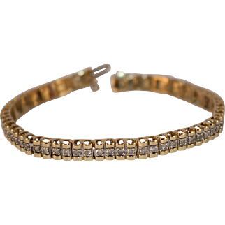 Beautiful 10K Gold and Diamond Tennis Bracelet with Safety Clasp with appraisal.