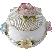Large porcelain box with applied polychrome flowers