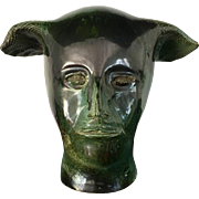 Mask of a Faun, green ceramic sculputure signed JR