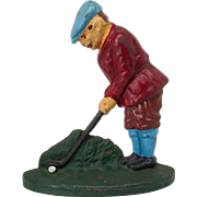 "Painted cast iron ""Golfer"" door stop"