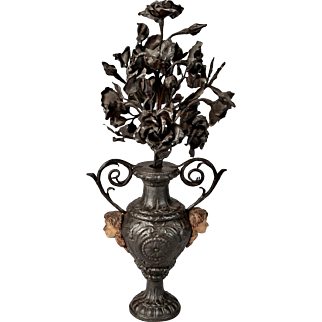19th Century French Iron Urn with Flowers and Putti Faces