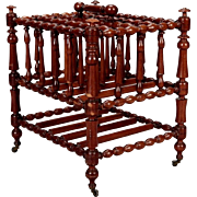 19th Century English Mahogany Magazine Rack with Bobbin Legs and Brass Casters
