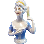 Antique Half Doll Wearing Blue with A Fan in Her Hand