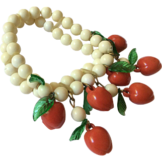 Cream Color Plastic Double Strand Bead Bracelet with Dangling Red Fruit with Leaves