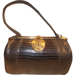Amazing 1940's glossy black lizard barrel bag with amazing cherub plaque to the front signed Sterling