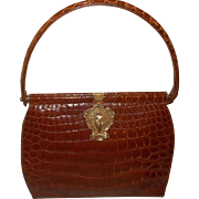 vintage 1940's crocodile skin honey colored handbag with brass art Nouveau lady front
