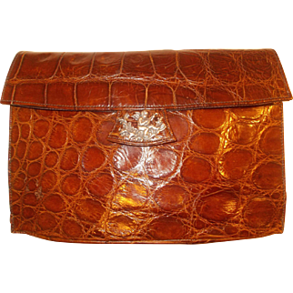 Vintage French 1930'S crocodile skin clutch bag with silver cherub to the front