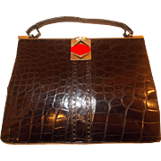 Vintage 1930's Art Deco glossy black crocodile skin handbag with a chrome and Bakelite frame