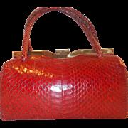 Lovely vintage red 1940's snakes skin barrel handbag with brass frame