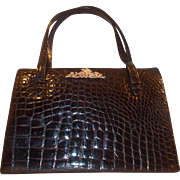 Stunning rare west German black crocodile handbag with silver cherubs