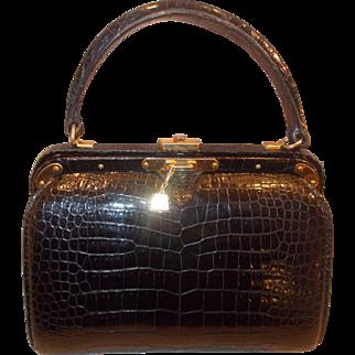 A very rare vintage 1950's Lederer alligator barrel handbag in mint condition