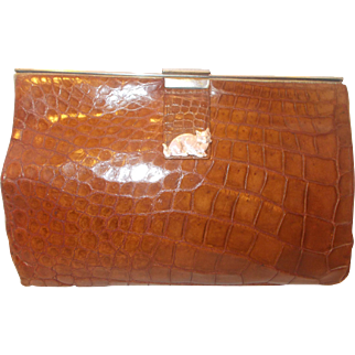Art Deco 1930's crocodile skin handbag with a fantastic silver cat pull tab