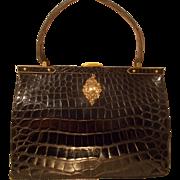 Large vintage 1930's glossy black French crocodile handbag with cherub front