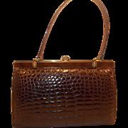 Vintage 1950's brown crocodile skin handbag with brass and enamelled frame