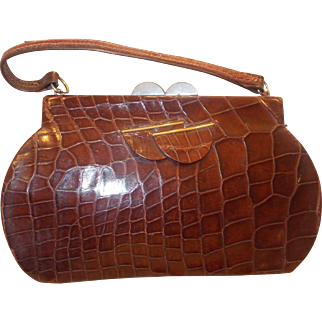 Fantastic Art Deco 1930's crocodile handbag with a chrome and Bakelite clasp