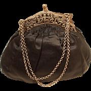 Antique silver cherub framed black silk handbag c 1910