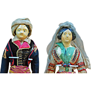 Pair all-original papier-mâché head dolls.