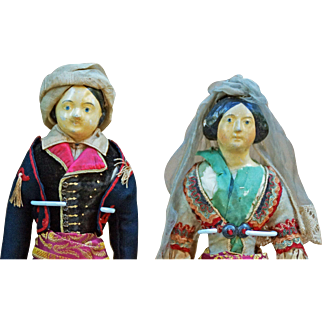 Pair all-original papier-mâché head dolls.