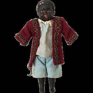 Rare composition shoulder head squeak toy doll,  circa 1900