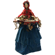 Superb early papier-mâché peddler doll