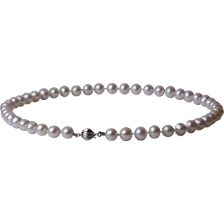 White cultured freshwater pearl necklace with a clasp  of white gold 14kt