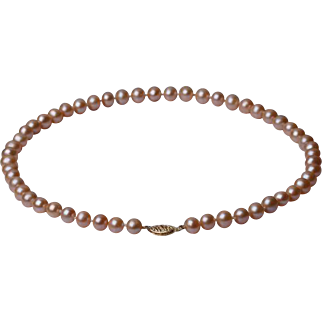 22 inches Necklace of pink freshwater cultured  pearls with clasp gold  14 karat