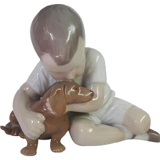 Bing & Grondahl porcelain Denmark - boy hugging his friend the dog
