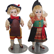 "Antique German 4"" All Bisque Pair Boy & Girl in Original German Costumes"