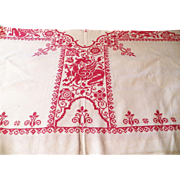 Victorian linen table topper featuring deep red cross stitching with a wide hand made lace border.