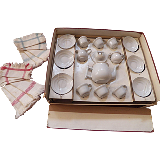 Vintage child's French enamelware tea set, complete with linens.