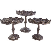 Set of three pierced and decorated 800 /1000 silver compotes