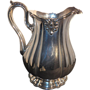 Large sterling silver water pitcher made by Howard & Co.