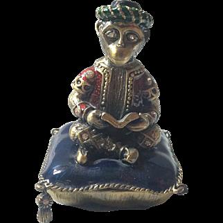Antique Brass/Bronze Monkey on Flying Carpet.
