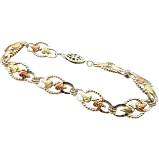 Sterling Silver and 12K Black Hills Rose, White and Yellow Gold Leaf Form Bracelet