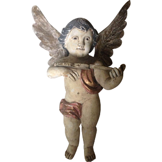 Antique cherub, angel sculpture playing violin