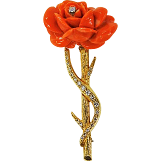 Vintage 14k brooch in the form of a rose with coral and diamond accents