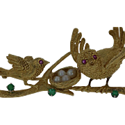 Estate vintage 18KY brooch featuring birds with rubies, emeralds and pearls.